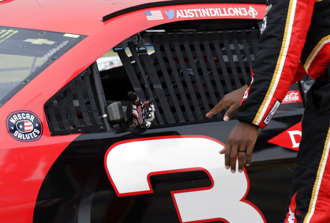 Austin Dillon greets his crew members as he drives to the track during the NASCAR Cup Series auto race at Chicagoland Speedway in Joliet, Ill., Sunday, June 30, 2019. (AP Photo/Nam Y. Huh)