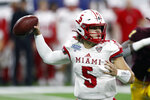 FILE - In this Dec. 7, 2019, file photo, Miami of Ohio quarterback Brett Gabbert throws during the second half of the Mid-American Conference championship NCAA college football game against Central Michigan, in Detroit. The Mid-American Conference on Saturday, Aug. 8, 2020, became the first league competing at college football's highest level to cancel its fall season because of COVID-19 concerns. With the MAC's 12 schools facing a significant financial burden by trying to maintain costly coronavirus protocols, the conference's university presidents made the decision to explore a spring season. (AP Photo/Carlos Osorio, File)