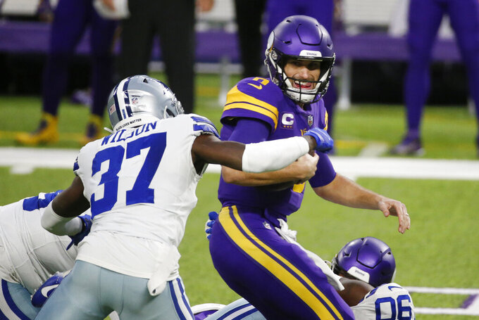 Dallas Cowboys safety Donovan Wilson (37) sacks Minnesota Vikings quarterback Kirk Cousins, right, during the first half of an NFL football game, Sunday, Nov. 22, 2020, in Minneapolis. (AP Photo/Bruce Kluckhohn)
