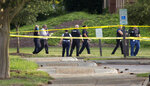 FILE - In this May 31, 2019 file photo, police work the scene where multiple people were killed during a mass shooting at the Virginia Beach city public works building in Virginia Beach, Va. An independent probe into Virginia Beach's mass shooting failed to offer clear answers as to why a city engineer opened fire in his workplace, the findings released Wednesday, Nov. 13, showed. (L. Todd Spencer/The Virginian-Pilot via AP, File)
