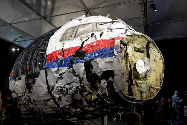 FILE - This Tuesday, Oct. 13, 2015 file photo, shows the reconstructed wreckage of Malaysia Airlines Flight MH17, put on display during a press conference in Gilze-Rijen, central Netherlands. United by grief across oceans and continents, families who lost loved ones when Malaysia Airlines Flight 17 was shot down in 2014 hope that a trial starting next week will finally deliver them something that has remained elusive ever since: The truth. (AP Photo/Peter Dejong, File)