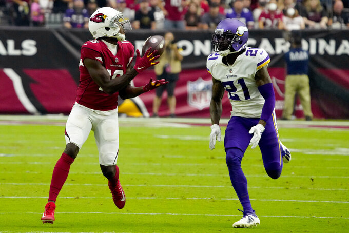 Arizona Cardinals wide receiver A.J. Green pulls in a catch as Minnesota Vikings defensive back Bashaud Breeland (21) defends during the second half of an NFL football game, Sunday, Sept. 19, 2021, in Glendale, Ariz. (AP Photo/Rick Scuteri)