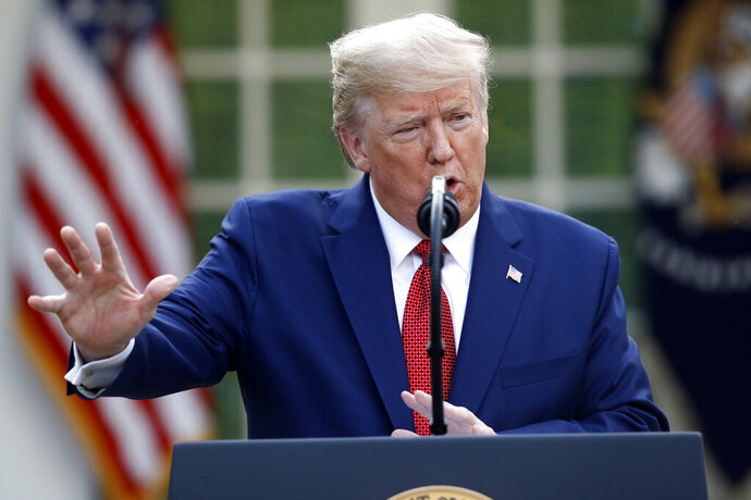 President Donald Trump speaks during a coronavirus task force briefing in the Rose Garden of the White House, Sunday, March 29, 2020, in Washington. (AP Photo/Patrick Semansky)