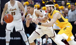 Valparaiso's John Kiser, right, and Loyola of Chicago's Lucas Williamson chase a loose ball during the first half of an NCAA college basketball game in the quarterfinal round of the Missouri Valley Conference tournament, Friday, March 8, 2019, in St. Louis. (AP Photo/Jeff Roberson)