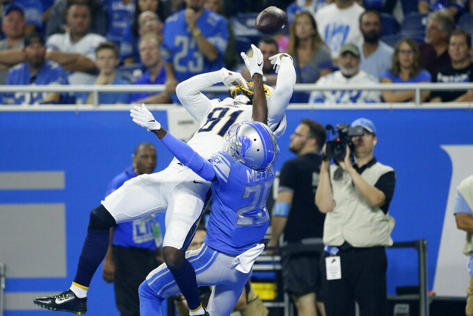 Los Angeles Chargers wide receiver Mike Williams (81) tries to catch the ball as Detroit Lions cornerback Rashaan Melvin (29) defends in the first half of an NFL football game in Detroit, Sunday, Sept. 15, 2019. (AP Photo/Duane Burleson)
