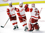 Detroit Red Wings defenseman Mike Green (25) and right wing Anthony Mantha (39) congratulate goaltender Jimmy Howard (35) after the Red Wings defeated the Nashville Predators 3-2 in an NHL hockey game Tuesday, Feb. 12, 2019, in Nashville, Tenn. (AP Photo/Mark Humphrey)
