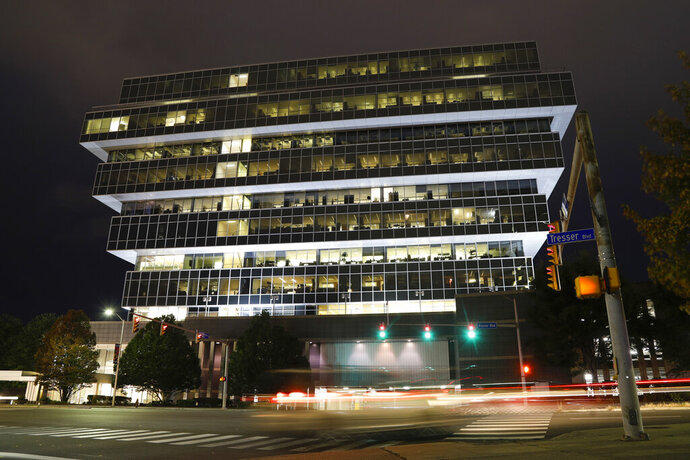 FILE - In this Sept. 12, 2019, file photo, cars pass Purdue Pharma headquarters at night in Stamford, Conn. OxyContin maker Purdue Pharma should not be able to make any more political contributions without a judge's permission, lawyers for its creditors said in a Friday, July 10, 2020 court filing. (AP Photo/Frank Franklin II, File)