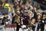 FILE - In this Nov. 24, 2018, file photo, Texas A&M wide receiver Quartney Davis (1) celebrates after catching a touchdown pass during the seventh overtime of an NCAA college football game against LSU, in College Station, Texas. Texas A&M won 74-72. The NCAA football rules committee has proposed giving replay officials more leeway to overturn targeting fouls and recommended that games reaching a fifth overtime period be decided by alternating 2-point conversion tries. The rules committee met in Indianapolis this week and announced on Friday, March 1, 2019,its proposed changes, including tweaks to kickoffs and blind-side blocks. The proposals must be approved by the football oversight committee in April. They would go into effect next season.(AP Photo/David J. Phillip, File)