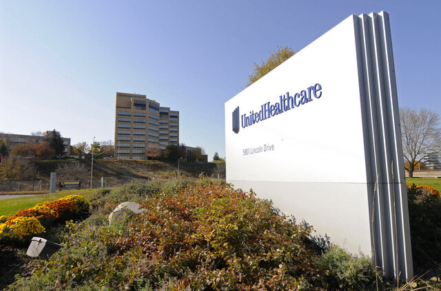 FILE - This Oct. 16, 2012, file photo, shows a portion of the UnitedHealth Group Inc.'s campus in Minnetonka, Minn. UnitedHealth has debuted a lower-than-expected 2021 earnings forecast partly because of COVID-19's still-foggy impact on the health care system. The nation's largest health insurance provider said Tuesday, Dec. 1, 2020, that it expects to take a hit from treatment and testing costs tied to the ongoing pandemic.  (AP Photo/Jim Mone, File)
