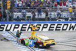 Kyle Busch celebrates with the fans after winning the NASCAR Xfinity Series auto race at Nashville Superspeedway on Saturday, June 19, 2021, in Lebanon, Tenn. (AP Photo/Mark Humphrey)