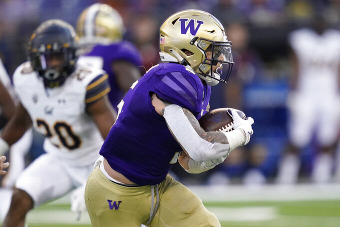 Washington running back Sean McGrew carries the ball during the first half of an NCAA college football game against California, Saturday, Sept. 25, 2021, in Seattle. (AP Photo/Elaine Thompson)