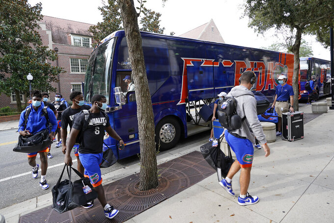 Florida players arrive at Ben Hill Griffen Stadium before an NCAA college football game against South Carolina, Saturday, Oct. 3, 2020, in Gainesville, Fla. (AP Photo/John Raoux,Pool)