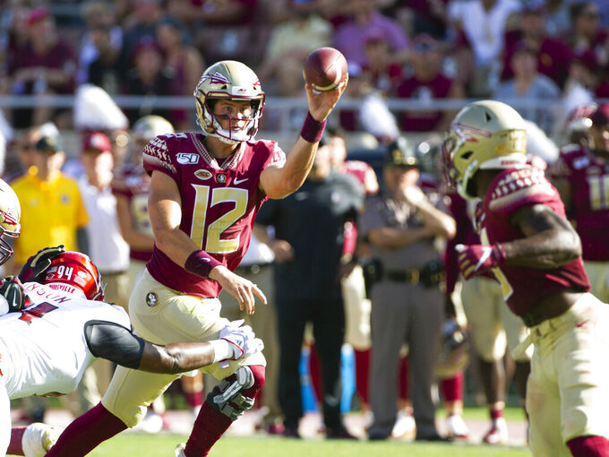 Florida State quarterback Alex Hornibrook (12) passes underneath to running back Cam Akers (3) in the first half of an NCAA college football game against Louisville in Tallahassee, Fla., Saturday, Sept. 21, 2019.