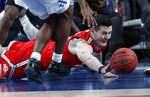 Ohio State's Kyle Young (25) dives for the ball against Kentucky during the first half of an NCAA college basketball game Saturday, Dec. 21, 2019, in Las Vegas. (AP Photo/John Locher)