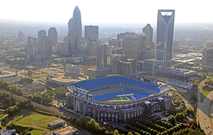 FILE - In this Aug. 16, 2012 file photo, the skyline of Charlotte, N.C., rises behind Bank of America Stadium in this aerial photo. Major League Soccer will try to reach an agreement for its 30th team to be in Charlotte. Carolina Panthers owner David Tepper made a presentation to MLS owners and said he would own the team and they would play at Bank of America Stadium.  (AP Photo/Chuck Burton, File)