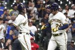 Milwaukee Brewers' Avisail Garcia is congratulated by Christian Yelich after hitting a two-run home run during the seventh inning of a baseball game against the Philadelphia Phillies Tuesday, Sept. 7, 2021, in Milwaukee. (AP Photo/Morry Gash)