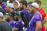 Minnesota Vikings linemen Christian Darrisaw, right, front, watches drills during NFL football training camp Wednesday, July 28, 2021, in Eagan, Minn. (AP Photo/Bruce Kluckhohn)