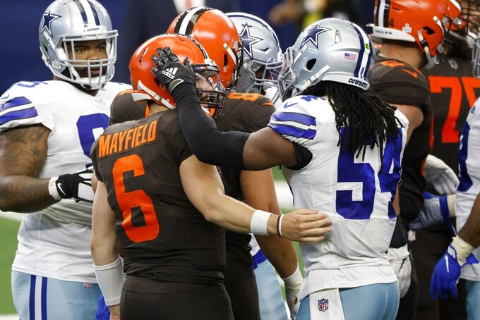 Cleveland Browns' Baker Mayfield (6) and Dallas Cowboys' Jaylon Smith (54) greet each other after their NFL football game in Arlington, Texas, Sunday, Oct. 4, 2020. The Browns won 49-38. (AP Photo/Ron Jenkins)