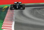 Mercedes driver Valtteri Bottas of Finland steers his car during the Formula One Grand Prix at the Barcelona Catalunya racetrack in Montmelo, Spain, Sunday, Aug. 16, 2020. (Josep Lago, Pool via AP)