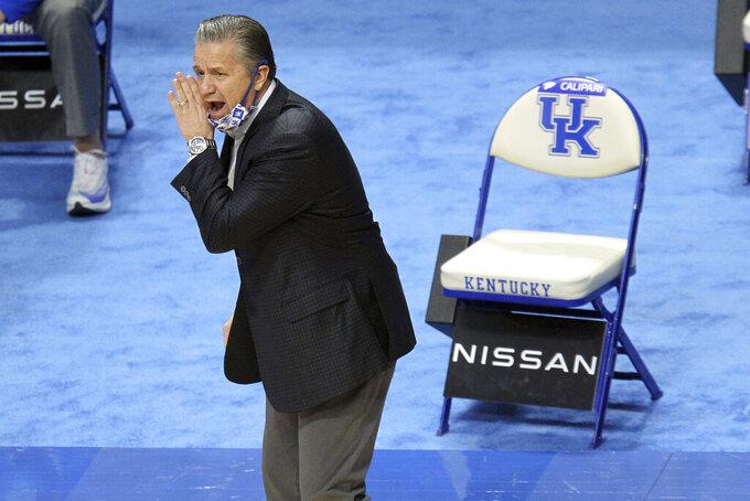 Kentucky head coach John Calipari yells to his team during the first half of an NCAA college basketball game against LSU in Lexington, Ky., Saturday, Jan. 23, 2021. (AP Photo/James Crisp)