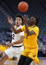 Wyoming's A.J. Banks, right, drives around Colorado's Daylen Kountz during the first half on an NCAA college basketball game Sunday, Nov. 24, 2019, in Las Vegas. (AP Photo/John Locher)