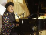 """FILE - In this July 22, 2001 file photo, Little Richard performs at the 93rd birthday and 88th year in show business gala celebration for Milton Berle, in Beverly Hills, Calif. Little Richard, the self-proclaimed """"architect of rock 'n' roll"""" whose piercing wail, pounding piano and towering pompadour irrevocably altered popular music while introducing black R&B to white America, has died Saturday, May 9, 2020. (AP Photo/John Hayes, File)"""