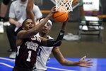 Mississippi State guard Iverson Molinar (1) gets past Saint Louis guard Jordan Goodwin (0) for a shot during the second half of an NCAA college basketball game in the first round of the NIT Tournament, Saturday, March 20, 2021, in Frisco, Texas. (AP Photo/Tony Gutierrez)