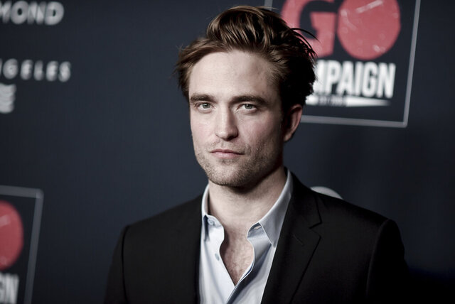 "FILE - In this Nov. 16, 2019 file photo, Robert Pattinson attends the 13th Annual Go Gala at NeueHouse Hollywood in Los Angeles.  The U.K. production of ""The Batman"" starring Pattinson, is starting up again after being shut down earlier this month when an individual tested positive for COVID-19. A spokesperson for Warner Bros. said Thursday, Sept. 17, 2020,  that filming had resumed after a hiatus for quarantine precautions.  (Photo by Richard Shotwell/Invision/AP)"