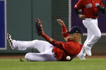 Boston Red Sox right fielder Gorkys Hernandez slides but cannot make the play on a single by Baltimore Orioles' Hanser Alberto in the sixth inning of a baseball game at Fenway Park, Friday, Sept. 27, 2019, in Boston. (AP Photo/Elise Amendola)