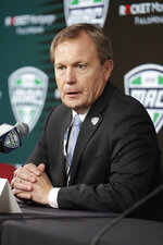 Mid-American Conference Commissioner Jon Steinbrecher speaks to the media Thursday, March 12, 2020, in Cleveland. The Mid-American Conference men's basketball tournament was cancelled at an arena scheduled to be the site of NCAA men's tournament games next week. (AP Photo/Tony Dejak)