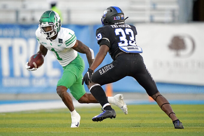 North Texas wide receiver Jaelon Darden (1) carries the ball against Middle Tennessee cornerback Decorian Patterson (33) in the first half of an NCAA college football game Saturday, Oct. 17, 2020, in Murfreesboro, Tenn. (AP Photo/Mark Humphrey)