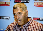 New Mexico State athletics director Mario Moccia speaks at a press conference in Albuquerque, N.M., on Friday, Sept. 20, 2019 during an announcement that the Aggies has signed six-year deal with ESPN events around bowl games. (AP Photo/Russell Contreras)