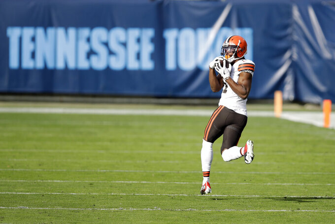 Cleveland Browns wide receiver Donovan Peoples-Jones (11) catches a 75-yard touchdown pass against the Tennessee Titans in the first half of an NFL football game Sunday, Dec. 6, 2020, in Nashville, Tenn. (AP Photo/Ben Margot)