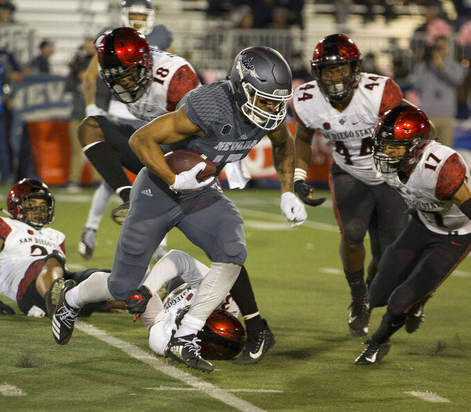 Nevada receiver Brendan O'Leary-Orange (17) runs for a touchdown against San Diego State in the first half of an NCAA college football game in Reno, Nev., Saturday, Oct. 27, 2018. (AP Photo/Tom R. Smedes)