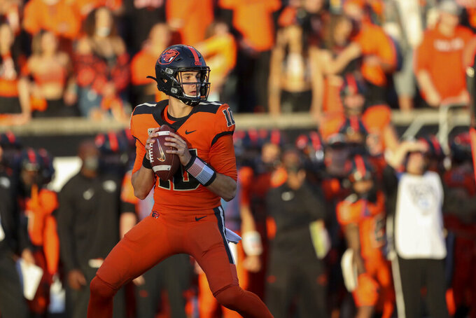 Oregon State quarterback Chance Nolan (10) looks for an open teammate during the first half of an NCAA college football game against Washington on Saturday, Oct. 2, 2021, in Corvallis, Ore. (AP Photo/Amanda Loman)