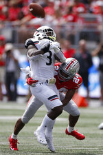 Ohio State defensive back Shaun Wade, right, breaks up a pass intended for Cincinnati running back Michael Warren during the first half of an NCAA college football game Saturday, Sept. 7, 2019, in Columbus, Ohio. (AP Photo/Jay LaPrete)