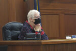 Alaska House Speaker Louise Stutes looks out onto the House floor on Tuesday, Aug. 31, 2021, in Juneau Alaska. The Alaska Legislature is meeting in a special session with the dividend paid to residents each year one of the topics. (AP Photo/Becky Bohrer)