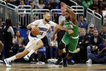 Orlando Magic guard Evan Fournier (10) drives to the basket against Boston Celtics guard Brad Wanamaker during the second half of an NBA basketball game, Friday, Jan. 24, 2020, in Orlando, Fla. (AP Photo/John Raoux)