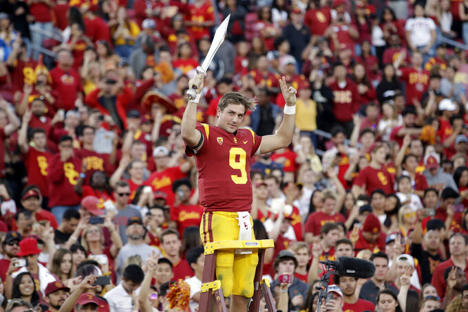 Southern California quarterback Kedon Slovis (9) directs the school's band after a 52-35 win over UCLA in an NCAA college football game, Saturday, Nov. 23, 2019, in Los Angeles. (AP Photo/Marcio Jose Sanchez)