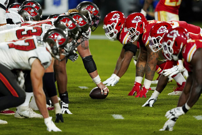 FILE - In this Feb. 7, 2021, file photo, the Tampa Bay Buccaneers offense, left, gets set at the line of scrimmage against the Kansas City Chiefs defense during the second half of the NFL Super Bowl 55 football game in Tampa, Fla. As COVID-19 and Delta variant positives increase across America, the NFL kicks off its first preseason since 2019 expecting the usual crowds. The league says more than 90% of its players have either begun or concluded the vaccination process. Nine teams have more than 95% of their players vaccinated, while a total of 27 teams is above 85%. (AP Photo/Steve Luciano, File)