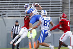 Duke wide receiver Jake Bobo (19) makes the reception as North Carolina State safety Tanner Ingle (10) defends during the first half of an NCAA college football game at Carter-Finley Stadium in Raleigh, N.C., Saturday, Oct. 17, 2020. (Ethan Hyman/The News & Observer via AP)