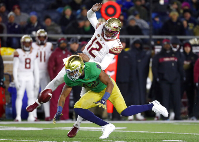 Notre Dame defensive lineman Julian Okwara (42) dives for a pass intended for Florida State quarterback Deondre Francois (12) in the first half of an NCAA college football game in South Bend, Ind.,Saturday, Nov. 10, 2018. (AP Photo/Paul Sancya)