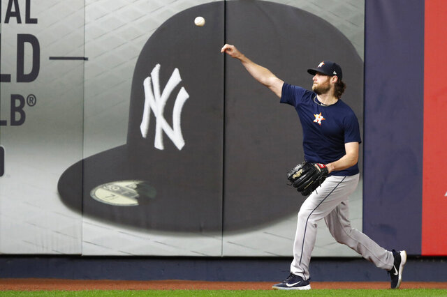 FILE - In this Monday, Oct. 14, 2019, file photo, Houston Astros Game 3 starting pitcher Gerrit Cole throws on the field at Yankee Stadium in New York, after the team arrived to prepare for the American League Championship Series, against the New York Yankees. Cole and the New York Yankees have agreed to a record $324 million, nine-year deal, a person familiar with the contract told The Associated Press, late Tuesday, Dec. 10, 2019. (AP Photo/Kathy Willens, File)