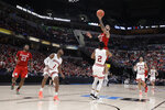 Nebraska's Haanif Cheatham (22) puts up a shot against Indiana's Armaan Franklin (2) during the second half of an NCAA college basketball game at the Big Ten Conference tournament, Wednesday, March 11, 2020, in Indianapolis. Indiana won 89-64. (AP Photo/Darron Cummings)