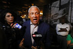 Mike Espy speaks to reporters in Jackson, Miss., after winning the Democratic nomination for a U.S. Senate seat in Mississippi, Tuesday, March 10, 2020. After his victory Tuesday, he will face Republican incumbent U.S. Sen. Cindy Hyde-Smith and Libertarian candidate Jimmy Edwards in November. (AP Photo/Rogelio V. Solis)