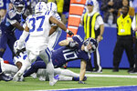 Tennessee Titans wide receiver Adam Humphries (10) reaches in for a touchdown in front of Indianapolis Colts safety Khari Willis (37) during the first half of an NFL football game in Indianapolis, Sunday, Dec. 1, 2019. (AP Photo/Darron Cummings)