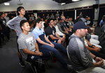 New York Yankees starting pitcher Masahiro Tanaka, of Japan, left, sits with his teammates as starting pitcher CC Sabathia speaks during a news conference at the New York Yankees spring training baseball facility, Saturday, Feb. 16, 2019, in Tampa, Fla. Sabathia announced he will retire after the 2019 season.(AP Photo/Lynne Sladky)
