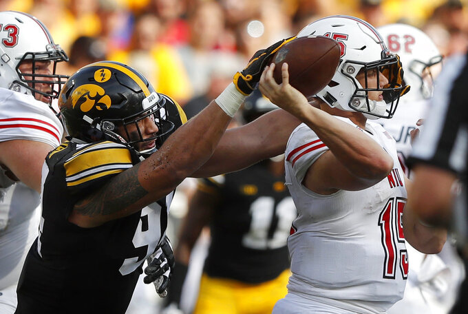 FILE - In this Sept. 1, 2018, file photo, Iowa defensive end A.J. Epenesa, left, pressures Northern Illinois quarterback Marcus Childers during the second half of an NCAA college football game, in Iowa City, Iowa. Iowa's dominant defensive line will be a major challenge for Minnesota freshman quarterback Zack Annexstad on Saturday, in the latest edition of the Floyd of Rosedale bronze pig trophy game. (AP Photo/Charlie Neibergall, File)