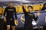 Missouri's Mark Smith, right, shoots in front of teammate Javon Pickett, right, during warmups before the start of an NCAA college basketball game against Liberty Wednesday, Dec. 9, 2020, in Columbia, Mo. (AP Photo/L.G. Patterson)