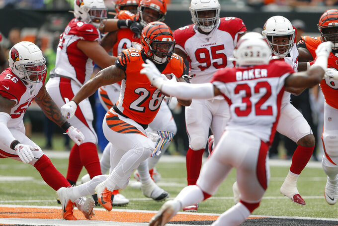 Cincinnati Bengals running back Joe Mixon (28) runs the ball in the first half of an NFL football game against the Arizona Cardinals, Sunday, Oct. 6, 2019, in Cincinnati. (AP Photo/Gary Landers)